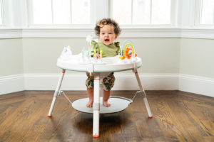 baby girl with skiphop activity center photographed by boston photographer nicole loeb
