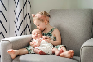 toddler with newborn baby brother photographed by boston photographer nicole loeb