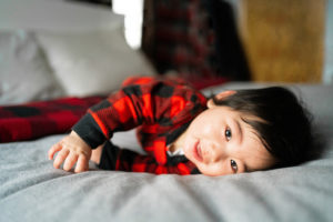 asian baby boy on bed photographed by boston photographer nicole loeb