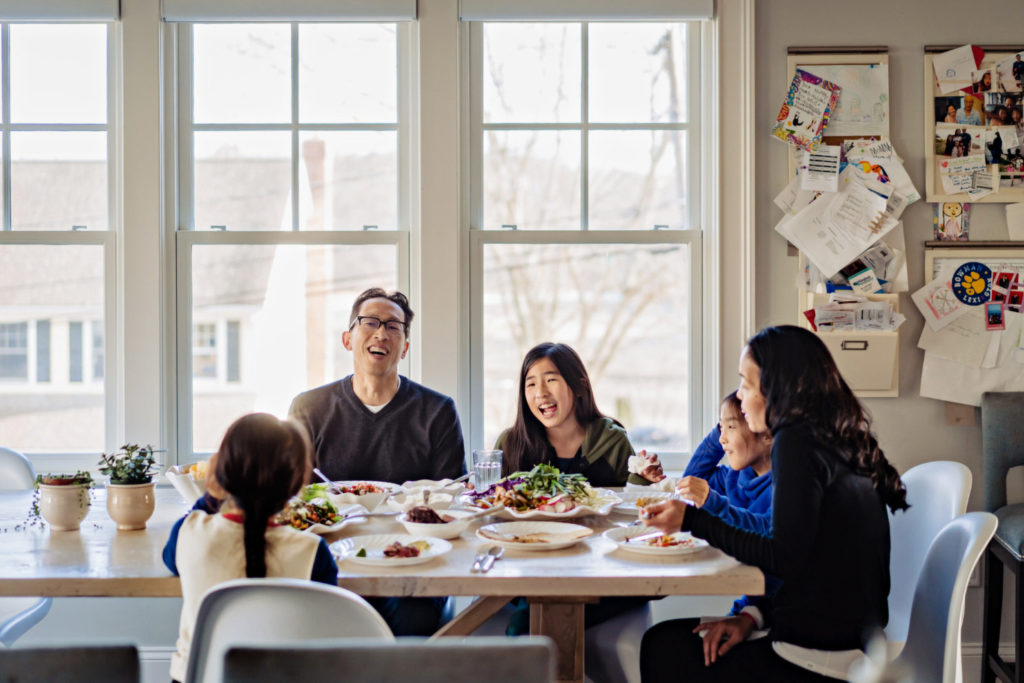 asian family eating dinner together photographed by boston photographer nicole loeb
