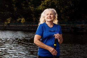dragonboat cancer survivor woman senior photographed by boston outdoor active photographer nicole loeb