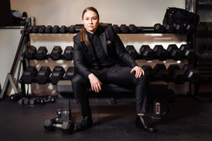 9 Tailors portrait of female in suit in gym setting photographed by boston photographer nicole loeb