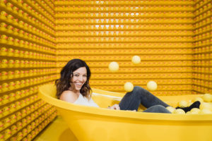 erica ferrone at happy place yellow photo in bathtub photographed by boston portrait photographer nicole loeb