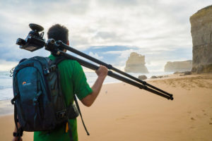 man with hasselblad camera, tripod, and lowepro camera backpack in australia photographed by Boston fitness and adventure photographer nicole loeb
