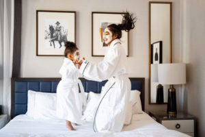 Black mother and toddler daughter in Whitney Hotel room spa night photographed by Boston photographer Nicole Chan