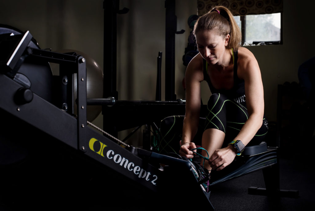 alicia golden female working out in concept 2 rower at A healthy balance gym in quincy photographed by Boston Photographer Nicole Loeb